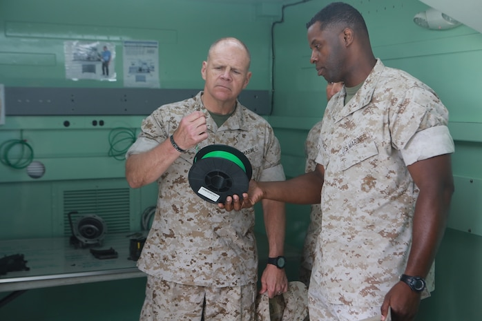 U.S. Marine Corps Lt. Col. Gregory Pace, commanding officer, 1st Maintenance Battalion, Combat Logistics Regiment 15, 1st Marine Logistics Group showed the spools of plastic that are used to create products using the 3D printers in the Expeditionary Manufacturing System with Gen. Robert Neller, Commandant of the Marine Corps on Camp Pendleton, Calif., May 24, 2016. The Expeditionary Manufacturing System is a mobile 3D printing and milling shop designed to provide quick turnaround for mission critical parts in deployed environment. (U.S. Marine Corps photo by Sgt. Rodion Zabolotniy, Combat Camera, Camp Pendleton/RELEASED)