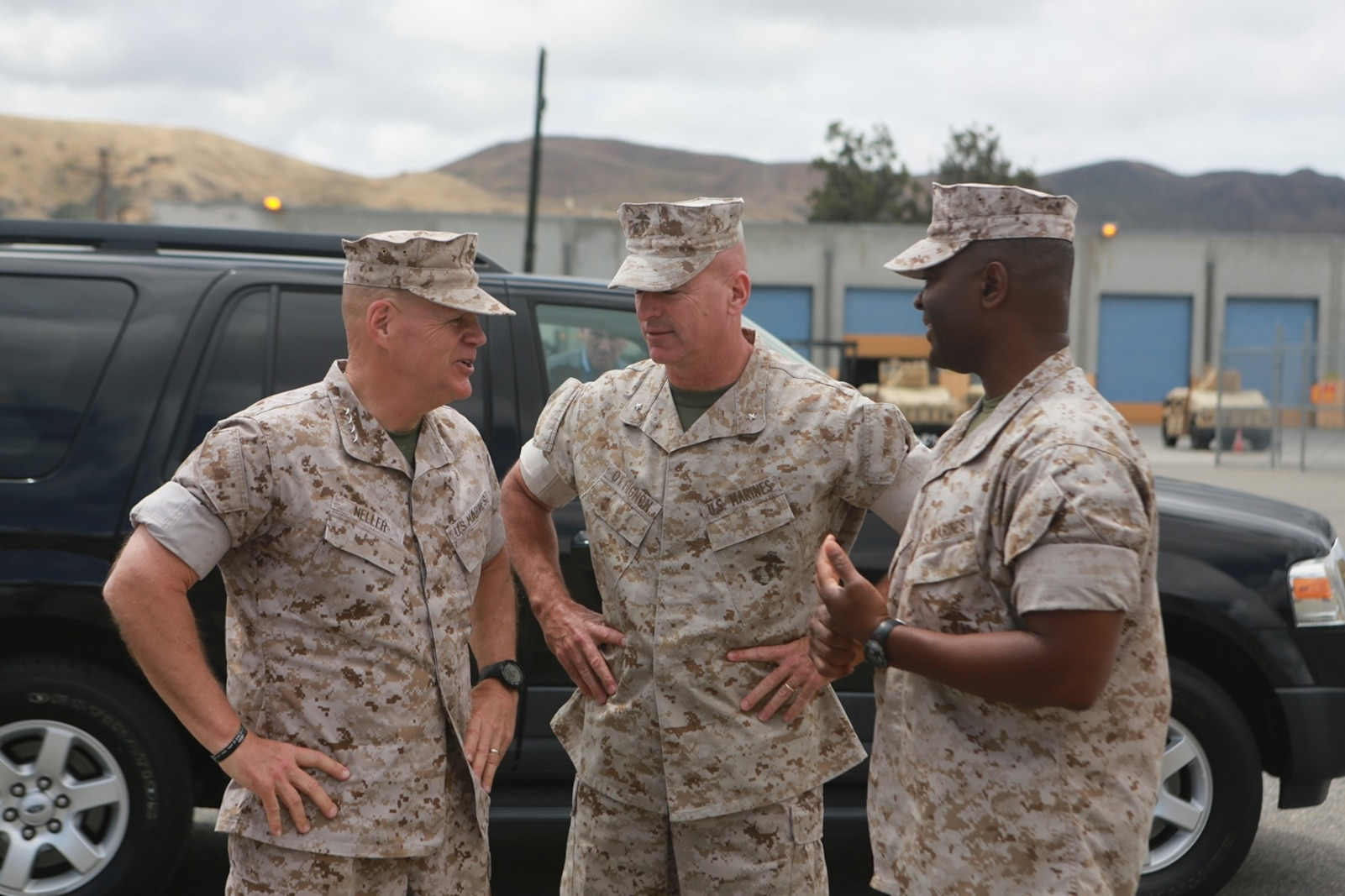 U.S. Marine Corps Gen. Robert Neller, Commandant of the Marine Corps, Brig. Gen. David Ottignon, commanding general, 1st Marine Logistics Group, and Col. Seth Ocloo, commanding officer, Combat Logistics Regiment 15, 1st MLG, talk about the current and future 3D printing operations using the Expeditionary Manufacturing System within the 1st MLG on Camp Pendleton, Calif., May 24, 2016. The Expeditionary Manufacturing System is a mobile 3D printing and milling shop designed to provide quick turnaround for mission critical parts in deployed environment. (U.S. Marine Corps photo by Sgt. Rodion Zabolotniy, Combat Camera, Camp Pendleton/RELEASED)