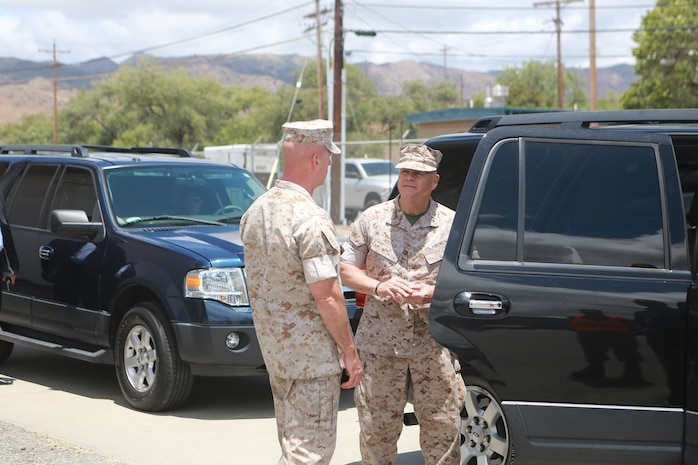 U.S. Marine Corps Gen. Robert Neller, Commandant of the Marine Corps, meets with Brig. Gen. David Ottignon, commanding general, 1st Marine Logistics Group to talk about the current and future 3D printing operations using the Expeditionary Manufacturing System within the 1st MLG on Camp Pendleton, Calif., May 24, 2016. The Expeditionary Manufacturing System is a mobile 3D printing and milling shop designed to provide quick turnaround for mission critical parts in deployed environment. (U.S. Marine Corps photo by Sgt. Rodion Zabolotniy, Combat Camera, Camp Pendleton/RELEASED)