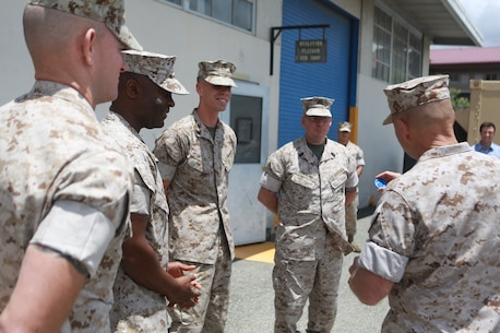 U.S. Marine Corps Gen. Robert Neller, Commandant of the Marine Corps, is presented a 3D printed Eagle Globe and Anchor from the Marines of 1st Maintenance Battalion, Combat Logistics Regiment 15, 1st Marine Logistics Group on Camp Pendleton, Calif., May 24, 2016. Gen. Neller addressed the future of the Marine Corps and answered questions from the Marines. (U.S. Marine Corps photo by Sgt. Rodion Zabolotniy, Combat Camera, Camp Pendleton/RELEASED)
