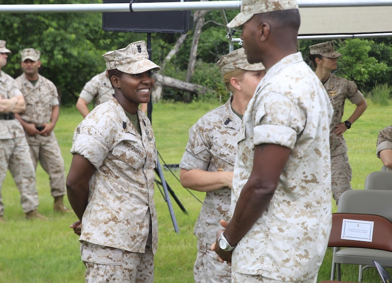 NAVAL SUPPORT FACILITY INDIAN HEAD, Md. – Master Chief Petty Officer Mercedes Hargrove, left, Navy senior enlisted advisor for Chemical Biological Incident Response Force (CBIRF), speaks to Sgt. Maj. Christopher Robinson, U.S. Marine Corps Forces Command (MARFORCOM)  sergeant major, prior to CBIRF change of command. Col. Michael L. Carter assumed command of CBIRF, MARFORCOM,  from Col. Stephen E. Redifer during a change of command ceremony aboard Naval Support Facility Indian Head, Md., May 18, 2016. Carter thanked Redifer for his outstanding work with CBIRF and said he was thankful for the opportunity to take command of the Nation's premier chemical, biological, radiological, nuclear and high-yield explosives (CBRNE) consequence management and incident response force in readiness. (U.S. Marine Corps by Sgt. Jonathan S. Herrera/Released)
