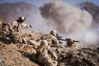 Marines and sailors conduct atraining attack on range 400 at Marine Corps Air Ground Combat Center Twentynine Palms, Calif., May 25, 2016. Marines use the complex range to test and improve combat readiness and skills. Navy photo by Petty Officer 1st Class Nathan Laird