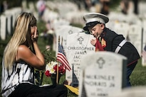 Brittany, left, and her son, Christian, 4, spend time at the grave of her husband and his father, Marine Corps Sgt. Christopher Jacobs, in Section 60 of Arlington National Cemetery in Arlington, Va., May 25, 2015. Christian wore his father's cover during the Memorial Day visit. Army photo by Rachel Larue