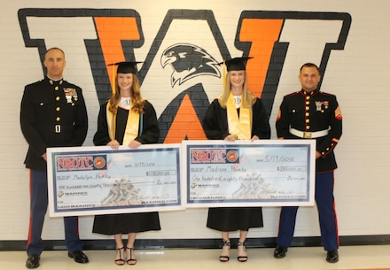 From left to right, U.S. Marine Corps Captain Brett J. Warming, the executive officer of Marine Corps Recruiting Station Raleigh, North Carolina, Madelyn M. Hamby and Madison N. Hamby, West Wilkes High School students, and Sgt. John F. Sanderson, a recruiter with Recruiting Station Raleigh, pose for a photo following an awards ceremony at West Wilkes High School in Wilkesboro, North Carolina, May 19, 2016. Madison and Madelyn received the Naval Reserve Officers Training Corps scholarship for their athleticism, academics and leadership capabilities. (U.S. Marine Corps photo by Sgt. Dwight A. Henderson/Released)