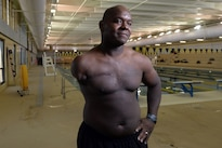 Retired Army Spc. Haywood Range III poses for a photo after a swimming event during the Army Trials for last year's Department of Defense Warrior Games held at Fort Bliss in El Paso, Texas, March 27, 2015. Athletes in this year's trials are competing for a spot on the Army's team in the 2016 Department of Defense Warrior Games. DoD photo by EJ Hersom