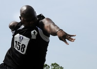 Army medically retired Spc. Haywood Range III throws the shot put during last year's DoD Warrior Games held at Marine Corps Base Quantico, Va., June 23, 2015. Range earned a gold medal in the men's standing 5.0 division. DoD photo by Shannon Collins