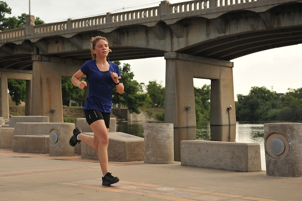 U.S. Air Force Airman 1st Class Alicia Hansen, 316th Training Squadron student, runs across Celebration Bridge during the Lt. Goodfellow 7.5k run in San Angelo, Texas, May 21, 2016. Goodfellow Air Force Base hosted the run to celebrate its 75th anniversary and the birth of 1st Lt. John J. Goodfellow. (U.S. Air Force by Airman 1st Class Caelynn Ferguson/Released)