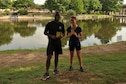 U.S. Air Force Airmen 1st Class Jamar Davis and Alicia Hansen, 316th Training Squadron students, hold their awards for being the fastest male and female runners in the Lt. Goodfellow 7.5k run at the Concho River in San Angelo, Texas, May 21, 2016. Goodfellow Air Force Base celebrated the anniversary of 1st Lt. John J. Goodfellow's birth and the 75th anniversary of the base with the run. (U.S. Air Force by Airman 1st Class Caelynn Ferguson/Released)