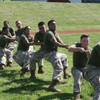 Marines in Service Company compete in tug-of-war at a safety stand-down and field meet sponsored by Headquarters and Service Battalion and CSACC May 25.