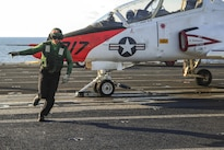 Navy Petty Officer Alexander Hogan runs off the runway after ensuring a T-45C Goshawk is ready for launch on the flight deck of the aircraft carrier USS George Washington in the Atlantic Ocean, May 23, 2016. The Washington is conducting carrier qualifications. Navy photo by Seaman Clemente A. Lynch