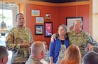 Fort Riley Garrison Commander Col. Andrew Cole Jr. speaks about contributions from Team Croom at a farewell lunch May 10 at a local restaurant in honor of Chap. (Col.) Keith Croom and his wife, Kelly, as they prepare to depart to the U. S. Army War College at Carlisle Barracks in Carlisle, Pennsylvania.