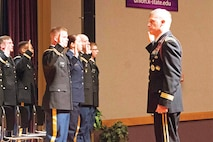 Maj. Gen. Wayne W. Grigsby Jr., 1st Infantry Division and Fort Riley commanding general, administers the oath of office to members of the Kansas State University Reserve Officers' Training Corps May 13 during their commissioning ceremony in K-State's Forum Hall. The 21 second lieutenants will go on to serve in units throughout the Army and Air Force.