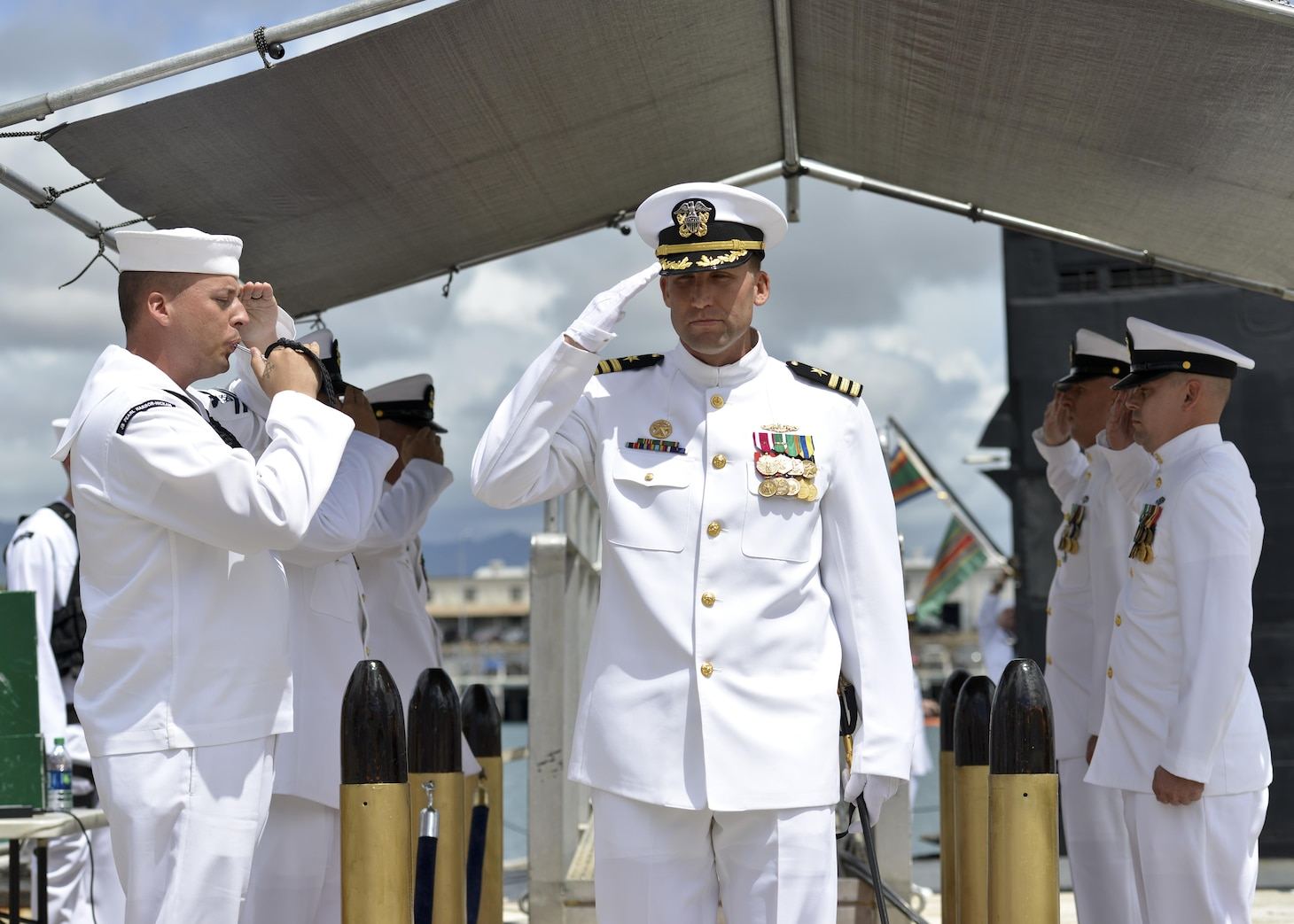 160525-N-LY160-246 JOINT BASE PEARL HARBOR-HICKAM, Hawaii (May 25, 2016) Commander Benjamin J. Selph, commanding officer, Los Angeles-class fast-attack submarine USS Olympia (SSN 717), salutes sideboys during a change-of-command ceremony in Joint Base Pearl Harbor-Hickam. (U.S. Navy photo by Mass Communication Specialist 2nd Class Michael H. Lee)