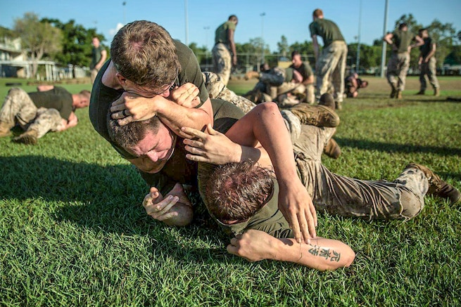 U.S. Marines grapple during squad-on-squad ground fighting at Robertson Barracks, Northern Territory, Australia, May 25, 2016. The  competition determined which rifle squad or weapons platoon section had the best physical fitness, small-unit leadership and cohesion. Marine Corps photo by Cpl. Mandaline Hatch