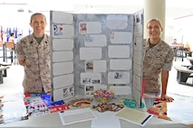 CAMP PENDLETON, Calif. --  Master Sgt. Tosha Reed, equal opportunity advisor with I Marine Expeditionary Force, and Sgt. Abbey Idalski, inspector general clerk with I MEF, showcase the Women's History Month exhibit during Camp Pendleton's Multi-Cultural Day at the Mainside Patio here, May 26. More than 40 Marines and civilians with Marine Corps Installations - West, 1st Marine Division, 1st Marine Logistics Group and I MEF set up booths and exhibits in order to foster a sense of unity among the diverse groups serving within the military.