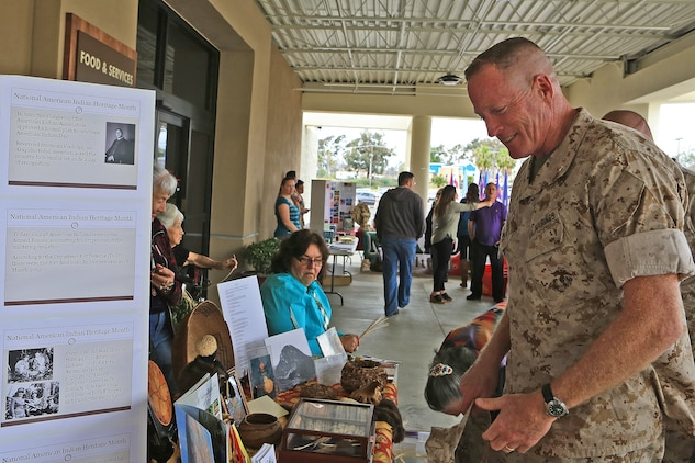 CAMP PENDLETON, Calif. -- Brig. Gen. Edward D. Banta, Commanding General, Marine Corps Installations - West, examines the National American Indian Heritage Month exhibit during Camp Pendleton's Multi-Cultural Day at the Mainside Patio here, May 26. More than 40 Marines and civilians with Marine Corps Installations - West, 1st Marine Division, 1st Marine Logistics Group and I Marine Expeditionary Force set up booths and exhibits in order to foster a sense of unity among the diverse groups serving within the military.