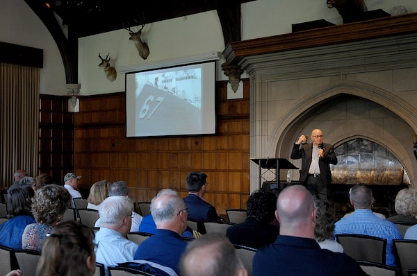 Mr. James Parlier, retired U.S. Navy command master chief, speaks to one of his slides during his keynote speech at the annual Spiritual and Emotional Care in Disasters Summit May 24, 2016, at the Glen Eyrie Castle in Colorado Springs, CO.