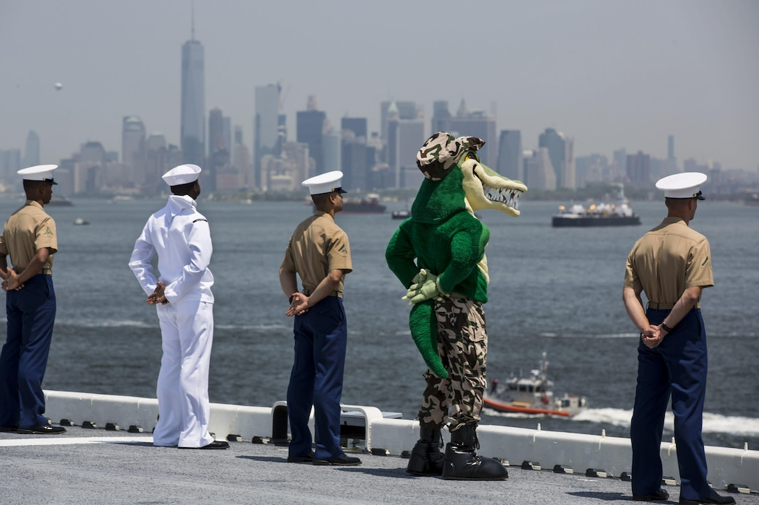 "Marines, sailors and a ""gator"" mascot aboard the USS Bataan man the rails during the parade of ships as part of Fleet Week New York in New York City, May 25, 2016. The Bataan transported more than 500 troops assigned to the 24th Marine Expeditionary Unit to the event. Marine Corps photo by Cpl. Todd F. Michalek"