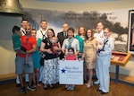 Participants pose following a news conference launching Blue Star Museums at the Hampton Roads Naval Museum, in Norfolk, Va., May 26, 2016. Blue Star Museums is a collaboration among the National Endowment for the Arts, Blue Star Families, the Department of Defense, and more than 2,000 museums across America to offer free admission to the nation's active duty military members and their families from Memorial Day through Labor Day. Navy photo by Petty Officer 3rd Class Amy M. Ressler