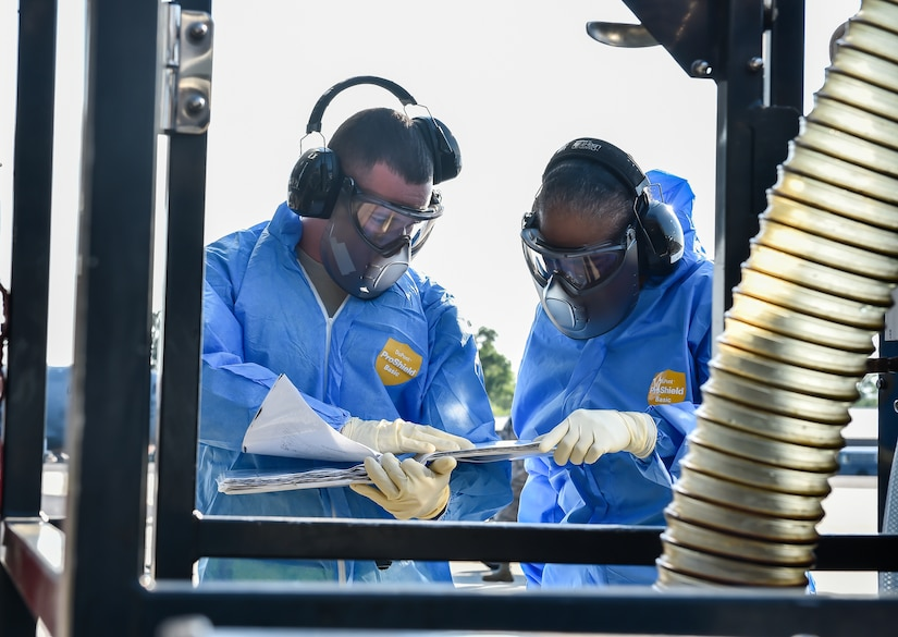 SrA Adgar Brown, a 437th Aerial Port Squadron fleet operations journeyman, teaches Command Chief Master Sgt. Shelina Frey, Air Mobility Command chief, how to clean the lavatory on a C-17 Globemaster III during her visit to Joint Base Charleston May 22 - 27, 2016. The mission of the 437th APS is to provide responsive global cargo and passenger movement operations while developing combat-ready Airmen. (U.S Air Force Photo/Airman Megan Munoz)
