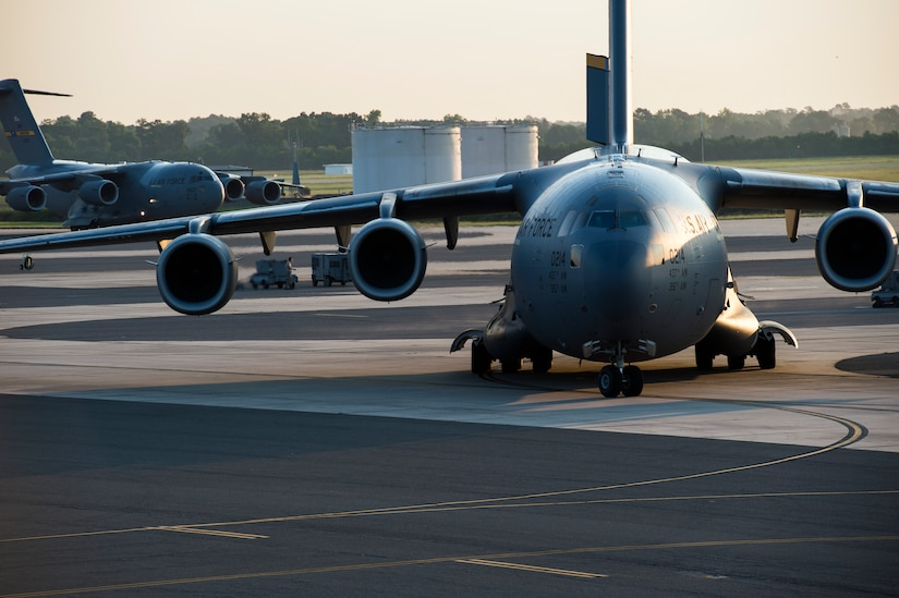 Two of 10 C-17 Globemaster IIIs taxi during a large formation exercise as part of Crescent Reach 16, May 26, 2016, at Joint Base Charleston, S.C. The exercise tested JB Charleston's ability to launch a large aircraft formation and mobilize a large amount of cargo and passengers. (U.S. Air Force photo/Staff Sgt. Jared Trimarchi)
