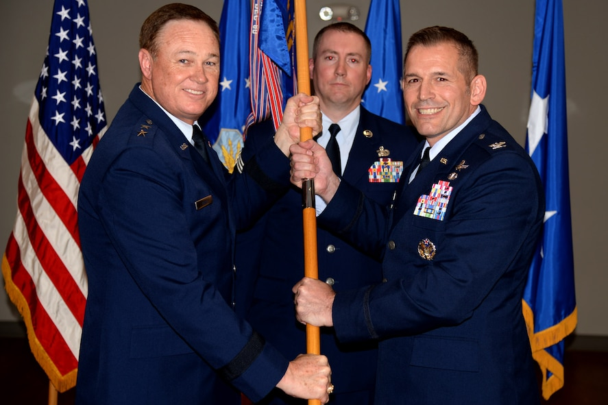 Col. Rocky Favorito accepts command of the 844th Communications Group during a change-of-command ceremony presided by Air Force District of Washington Commander Maj. Gen. Darryl Burke on Joint Base Andrews, Md., May 26, 2016. The 844th Communications Group provides communications and information support to Air Force National Capitol Region warfighters, including Headquarters Air Force District of Washington, the 11th Wing , 79th Medical Wing and various other organizations throughout the NCR. (U.S. Air Force photo/Tech. Sgt. Matt Davis)