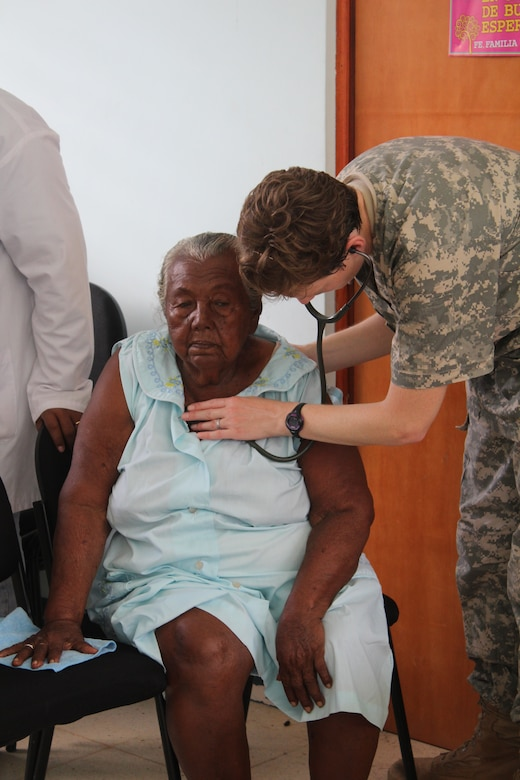 U.S. Army Capt. Angela Hunter, Joint Task Force-Bravo Medical Element physician assistant, examines an elderly woman's vital signs during a Medical Readiness Training Exercise in Alamikamba, Nicaragua, May 18, 2016. Hunter was part of a JTF-Bravo team that participated in a two-day exercise in Nicaragua which provided the local population with preventive care, basic health care services, dental care and medications free of charge. A total of 1,265 Nicaraguans received care during the MEDRETE, which included participation from Nicaraguan Ministry of Health and Army in cooperation with JTF-Bravo service members and Honduran medical liaisons from Soto Cano Air Base, Honduras.  (U.S. Army photo by Maria Pinel)