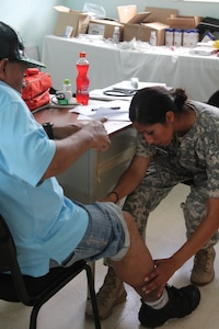 U.S. Army Sgt. 1st Class Veronica Badillo, Joint Task Force-Bravo Medical Element, examines a Nicaraguan man's leg during a consultation, while participating in a Medical Readiness Training Exercise, May 18, 2016, in Alamikamba, Nicaragua. MEDRETEs help validate service members' ability to provide care under austere conditions in remote locations, such as the Nicaraguan Miskito Coast, while providing an opportunity to help the host nation and build relationships between the U.S. and the Central American countries. A total of 1,265 Nicaraguans received care during the MEDRETE, which included participation from Nicaraguan Ministry of Health and Army in cooperation with JTF-Bravo service members and Honduran medical liaisons from Soto Cano Air Base, Honduras. (U.S. Army photo by Maria Pinel)