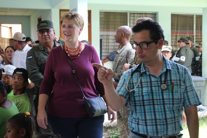 Dr. Carlos Duron, Joint Task Force-Bravo Medical Liaison, provides a tour of the distribution of medical services for Laura F. Doğu, Ambassador of the United States to Nicaragua, during a Medical Readiness Training Exercise. Ambassador Doğu visited the village along with US AID and Embassy representatives to witness first-hand the impact MEDRETEs have on a community. (U.S. Army photo by Maria Pinel)