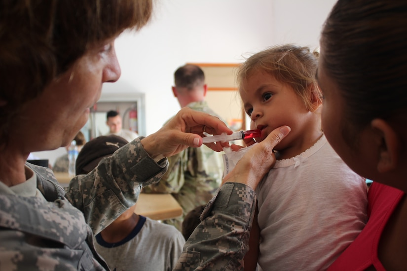 U.S. Army Capt. Katherine Matteson, Joint Task force-bravo public health nurse, applies deworming medication to a three-year-old girl as part of preventive medical care during a Medical Readiness Training Exercise, May 19, 2016, in Alamikamba, Nicaragua. The two-day exercise provided free health care for more than 1,200 patients from Alamikamba and other nearby communities. A total of 1,265 Nicaraguans received care during the MEDRETE, which included participation from Nicaraguan Ministry of Health and Army in cooperation with JTF-Bravo service members and Honduran medical liaisons from Soto Cano Air Base, Honduras.   (U.S. Army photo by Maria Pinel)