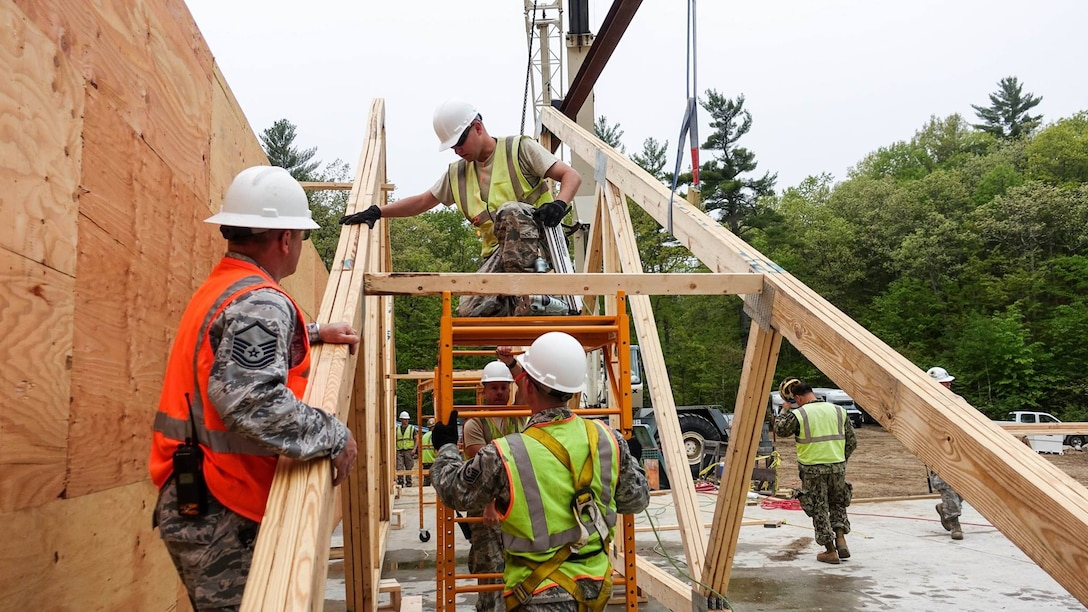 U.S. Airmen with the 139th Civil Engineer Squadron, Missouri Air National Guard, participate in Innovative Readiness Training (IRT), at William Hinds Boy Scout Camp in Raymond, Maine, on May 24, 2016. The IRT is part of a joint exercise with the U.S. Marines, Navy, Air National Guard, and Air Force Reserve to help rebuild parts of the camp. (U.S. Air National Guard photo by Senior Airman Sheldon Thompson/released)