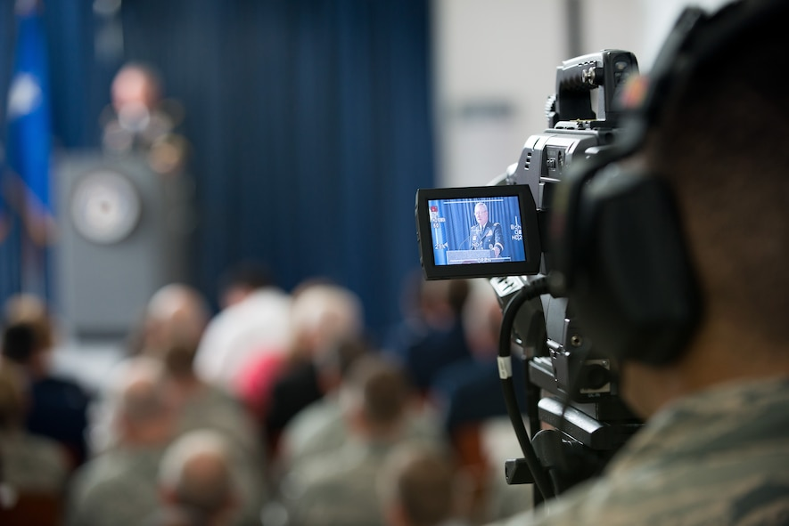 Tech. Sgt. Erik Gallion, a broadcaster assigned to the I.G. Brown Training and Education Center, operates a camera May 10, 2016, at the Air National Guard Readiness Center on Joint Base Andrews, Md., while Chief of the National Guard Bureau Army Gen. Frank J. Grass speaks during the assumption of command ceremony for the Director of the Air National Guard. (U.S. Air National Guard photo by Tech. Sgt. Jonathan Young/Released)