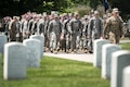 "Soldiers march into Arlington National Cemetery from Joint Base Myer-Henderson Hall to participate in ""Flags In"" at Arlington National Cemetery in Arlington, Va., May 26, 2016. The soldiers are assigned to the 3rd U.S. Infantry Regiment, known as ""The Old Guard."" Each of the cemetery's approximately 230,000 headstones receives a flag for the Memorial Day holiday. Army photo by Rachel Larue"