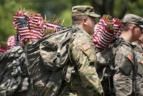 """Soldiers carry American flags in backpacks while participating in """"Flags In"""" at Arlington National Cemetery in Arlington, Va., May 26, 2016. Army photo by Rachel Larue"""
