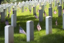 "American flags placed during ""Flags In"" stand in front of headstones at Arlington National Cemetery in Arlington, Va., May 26, 2016. Army photo by Rachel Larue"