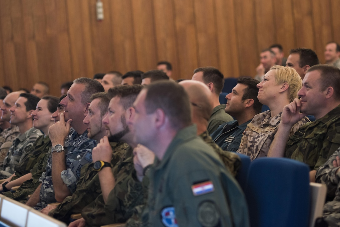 Members of the Inter-European Air Forces Academy at the Warrior Prep Center, Einsiedlerhof, Germany react to Gen. Frank Gorenc, commander U.S. Air Forces in Europe and Air Forces Africa, who spoke to them on May 10, 2016. (U.S. Air Force photo by Tech. Sgt. Paul Villanueva/Released)