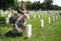 """Soldiers pay respects while participating in """"Flags In"""" at Arlington National Cemetery in Arlington, Va., May 26, 2016. DoD photo by Marvin D. Lynchard"""