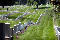 "American flags placed by soldiers participating in ""Flags In"" adorn the headstones at Arlington National Cemetery in Arlington, Va., May 26, 2016. DoD photo by Marvin D. Lynchard"