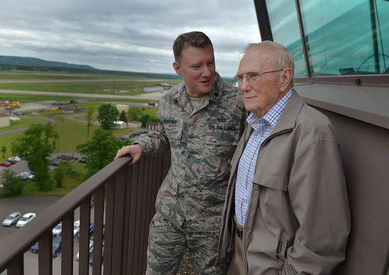 U.S. Air Force Lt. Col. Michael Andrews, Deputy Director, Public Affairs and Communication, USAFE-AFAFRICA, speaks with his grandfather, Chief Master Sgt. (Retired) Kenneth Andrews, while visiting the Air Traffic Control tower on Ramstein Air Base, Germany, May 24, 2016. Andrews entered the Air Force in 1947 and served 30 years as an Air Traffic Controller; three years of his service were spent at Ramstein.