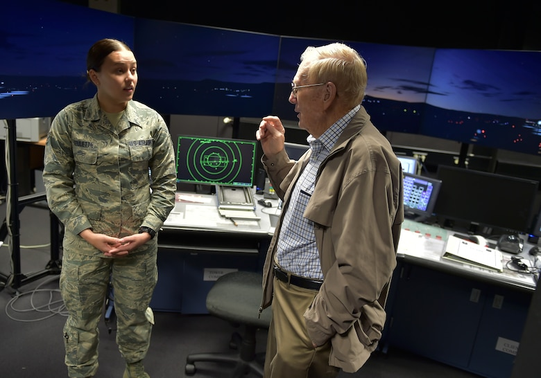 U.S. Air Force Chief Master Sgt. (Retired) Kenneth Andrews speaks with Airman 1st Class Paige Goulette, Air Traffic Control Apprentice, in the ATC simulator at Ramstein's Air Traffic Control tower, May 24, 2016, Ramstein Air Base, Germany.  Andrews visited the tower to speak with the Airman on duty and share his experiences as a former Air Traffic Controller during his 30-year AF career.  Andrews entered the AF in 1947 during the same year it became an independent service.