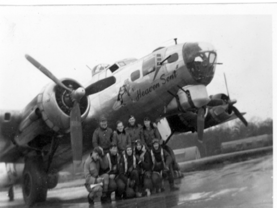 """The crew of B-17 Flying Fortress """"Heaven Sent"""" gather for a photograph with their aircraft immediately after landing from a mission over Germany during World War II. Back in 1944, Sept. 11 also brought tragedy when the 100th Bomb Group, from Thorpe Abbots, England, sent up its usual 36 aircraft. Thirteen of those were from the 350th BS; all 13 got shot down. (Courtesy photo provided by 100th Bomb Group Foundation/Released)"""