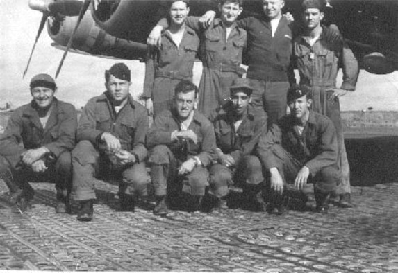 "Former Staff Sgt. Lewis Herron, top left, 350th Bomb Squadron tail gunner, poses with the rest of his crew from the ""Heaven Sent"" B-17 Flying Fortress, standing from left to right, Tech. Sgt. Glenn Smiley, 2nd Lt. Gerald Klecker and Tech. Sgt. William Jarrell; kneeling left to right, Tech. Sgt. Michael Garemko, 1st Lt. Tom Anderson, Staff Sgt. Angelo Cioffi and 1st Lt. Fred Schmidt, during their time stationed at Thorpe Abbots, England, during World War II. The 100th BG became nicknamed ""The Bloody Hundredth"" after suffering significant losses. (Courtesy photo provided by the 100th Bomb Group Foundation/Released)"