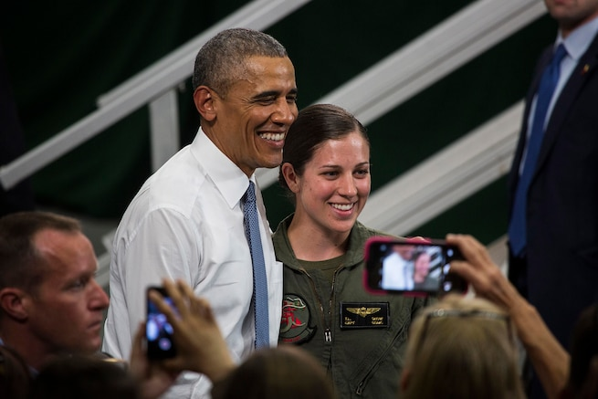 President Barack Obama poses with Capt. Tessa Snow, an Osprey pilot with Marine Medium Tiltrotor Squadron 265, during his visit to Marine Corps Air Station Iwakuni, Japan, May 27, 2016. Obama recognized Snow for her actions during the Kumamoto earthquake relief effort last month. U.S. Marine Corps photo by Cpl. Justin Fisher