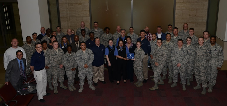 The 786th Force Support Squadron lodging team receives the First Sergeant's Team Award May 25, 2016, at Ramstein Air Base. The 786th FSS accommodated military dependents from Incirlik Air Base, Turkey from the time they were removed from Incirlik until they returned to the United States or moved to temporary housing at Ramstein to finish the remainder of the school year. (U.S. Air Force photo/ Airman 1st Class Joshua Magbanua)