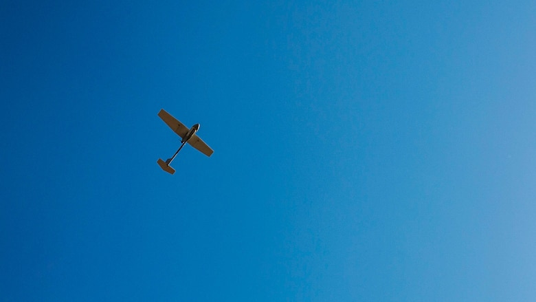 An unmanned aerial vehicle flies overhead during the UAV training portion of Khaan Quest 2016 at Five Hills Training Area near Ulaanbaatar, Mongolia, May 27. The training equipped MAF members with a deeper understanding of the purpose and operations of UAVs and how they can be used during peacekeeping missions. Khaan Quest 2016 is an annual, multinational peacekeeping operations exercise hosted by the Mongolian Armed Forces, co-sponsored by U.S. Pacific Command, and supported by U.S. Army Pacific and U.S. Marine Corps Forces, Pacific. Khaan Quest, in its 14th iteration, is the capstone exercise for this year's Global Peace Operations Initiative program. The exercise focuses on training activities to enhance international interoperability, develop peacekeeping capabilities, build to mil-to-mil relationships, and enhance military readiness. Godsey is assigned to 8th military Police Brigade.