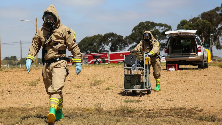 Marines with Explosive Ordnance Disposal walk toward the hazardous area during a Chemical, Biological, Radiological, Nuclear and High-Yield Explosives exercise at the gas chamber aboard Marine Corps Air Station Miramar, Calif., May 18, 2016. The exercise revolved around PMO, the Miramar Fire Department, Explosive Ordnance Disposal, and Aircraft Rescue and Firefighting working together to identify and eliminate the threat of a simulated clandestine drug lab.