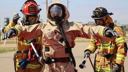 Firefighters with the Marine Corps Air Station Miramar Fire Department decontaminate a Marine with Explosive Ordnance Disposal after he entered the contaminated area during a Chemical, Biological, Radiological, Nuclear and High-Yield Explosives exercise at the gas chamber aboard Marine Corps Air Station Miramar, Calif., May 19, 2016. The exercise revolved around PMO, the Miramar Fire Department, Explosive Ordnance Disposal, and Aircraft Rescue and Firefighting working together to identify and eliminate the threat of a simulated clandestine drug lab.