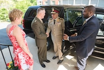 Marine Corps Gen. Joe Dunford, center left, chairman of the Joint Chiefs of Staff, shakes hands with Lt. Gen. Mahmoud Hegazy, chief of staff of Egypt's armed forces, as he arrives at Joint Base Myer-Henderson Hall, Va., May 26, 2016. DoD photo by Army Staff Sgt. Sean K. Harp
