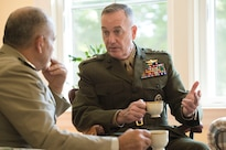 Marine Corps Gen. Joe Dunford, right, chairman of the Joint Chiefs of Staff, and Egyptian Defense Chief Lt. Gen. Mahmoud Hegazy, talk over coffee at Dunford's home at Joint Base Myer-Henderson Hall, Va., May 26, 2016. DoD photo by Army Staff Sgt. Sean K. Harp