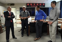 Pentagon Force Protection Agency Director Steven E. Calvery, left, and Pentagon Chief of Police James Ballard, second from left, meet with Mayor Andy Berke of Chattanooga, Tenn., third from right, and the city's police chief, Fred Fletcher during the Tennessee officials' visit to the agency, Aug. 21, 2015. On July 16, 2015, five U.S. service members died and two others were injured in an attack on a military recruiting center and another U.S. military site in Chattanooga. DoD photo by Shannon Giles